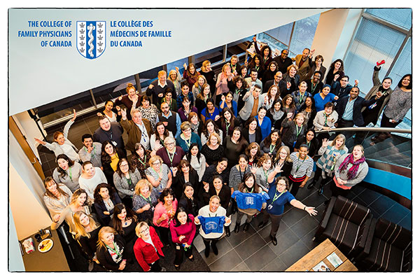 Group shot of CFPC employees in the foyer of the National office, celebrate the Great Place to Work certification